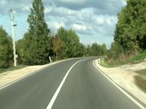 Car driving on a road. A car driving on a road on a sunny day stock footage