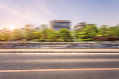 Car driving on road at sunset, motion blur Royalty Free Stock Images