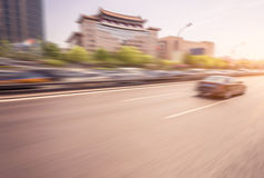 Car driving on road at sunset, motion blur Stock Photo