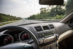 Car driving on road Stock Photography