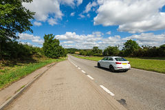 Car driving on the road Stock Images