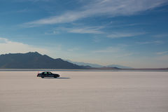 Car driving on Salt Flats Royalty Free Stock Photo