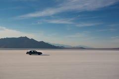 Car driving on Salt Flats Royalty Free Stock Photo