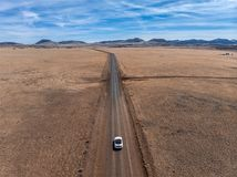 Car driving on sand desert scenic empty road at summer day. Travel concept Royalty Free Stock Photography