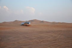 Car driving on the sand. Royalty Free Stock Photography