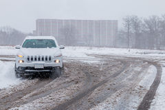 Car driving in slippery snow road Royalty Free Stock Image
