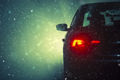 Car Driving In the Snow. Snowy Travel Conditions stock images