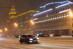 Car driving in snowfall in city Royalty Free Stock Image