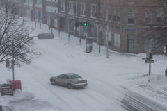 Car Driving in Snowstorm Royalty Free Stock Photography