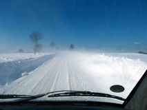 Car driving on snowy road with dirty windshield Royalty Free Stock Photos