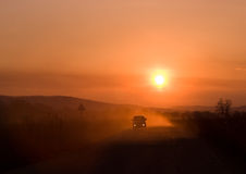 Car driving at sunset Royalty Free Stock Image