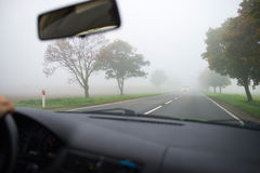 Car driving in thick fog Royalty Free Stock Photos