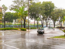 Car driving in tropical storm, Fort Lauderdale, USA Royalty Free Stock Photography