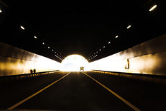 Car driving in tunnel exit Stock Photos