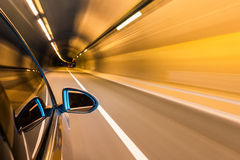 Car driving with tunnel motion blur Stock Photography