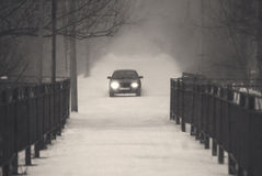 Car driving under snow. Misty road. royalty free stock image