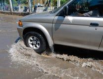 Car driving through water Stock Photo