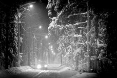 Car driving in winter forest covered with snow Royalty Free Stock Photography