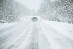 The car is driving on a winter road Stock Image