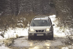 Car driving through the winter road Royalty Free Stock Photos