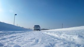 Car is driving on a winter road over the camera stock video footage