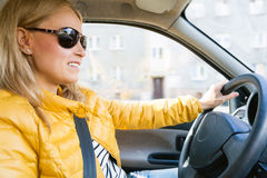 Car driving woman. Happy road trip sunny day royalty free stock photo