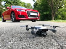 Car and drone parked on the road stock image