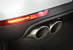 Car dual exhaust pipe. Close up of a car dual exhaust pipe Royalty Free Stock Image
