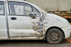 Car with duct tape repair. Damaged whire small car with duct tape repair royalty free stock photos