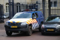 Car of the dutch military police named Koninklijke marechaussee at the Noordeinde palace in The Hague the Netherlands. Car of the dutch military police named stock photos