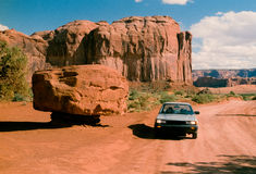 Car Dwarfed by Stone in Monument Valley Royalty Free Stock Photography