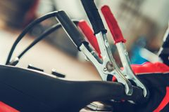 Car Electric Jumper Cables. Closeup Photo. Automotive Theme. Auto Service Equipment stock photos