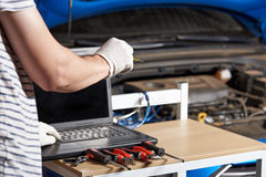 Car electronic maintenance. In professional garage workshop. Car computer diagnostic Royalty Free Stock Photos