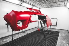 Car element body after painting. Drying parts of the automobile in spray booth. royalty free stock photos