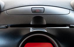 Car emergency button and CD/DVD player slot in driver place. stock images