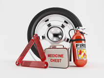 Car Emergency kit. A set consisting of a wheel, fire extinguisher, first aid kit and warning triangle Stock Photo