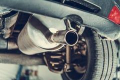 Car Emission Test Theme. Modern Compact Car Muffler Closeup stock photography