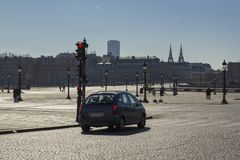 Car in an empty square in paris in the afternoon stock photo