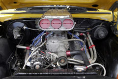 Car Engine. Large Powerful Car Engine, Metal Parts, Tubes, Gears etc Royalty Free Stock Photography