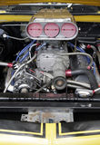 Car Engine. Large Powerful Car Engine, Metal Parts, Tubes, Gears etc Royalty Free Stock Images