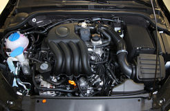 Car engine. Engine bay of a car designed in Germany & assembled in Mexico stock images