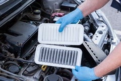 Car engine air filters, dirty and clean Stock Photography