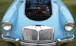 Car and engine bay. Blue car with engine bay visible Stock Photos