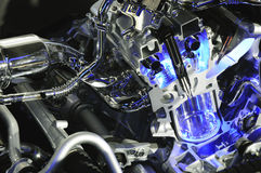 Car engine with blue beam. Powerful car engine with blue metal Stock Images