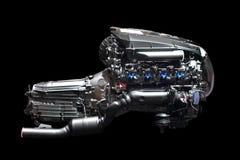 Car engine chrome. New car engine isolated on black background Stock Images