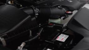 Car engine, expansion tanks, wires, hoses.