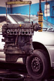 Car engine hanging in workshop Royalty Free Stock Photos