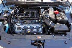 Car Engine. Hood open on car showing engine. Horizontal Stock Images