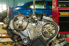 Car engine on a lift. Car engine repair on a lift in a garage royalty free stock image
