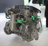 Car engine model. A model or display of a car engine on a showroom floor Stock Image
